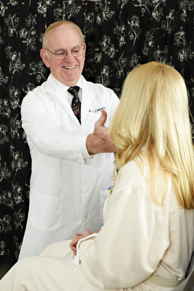 Dr. Sattler examining patient
